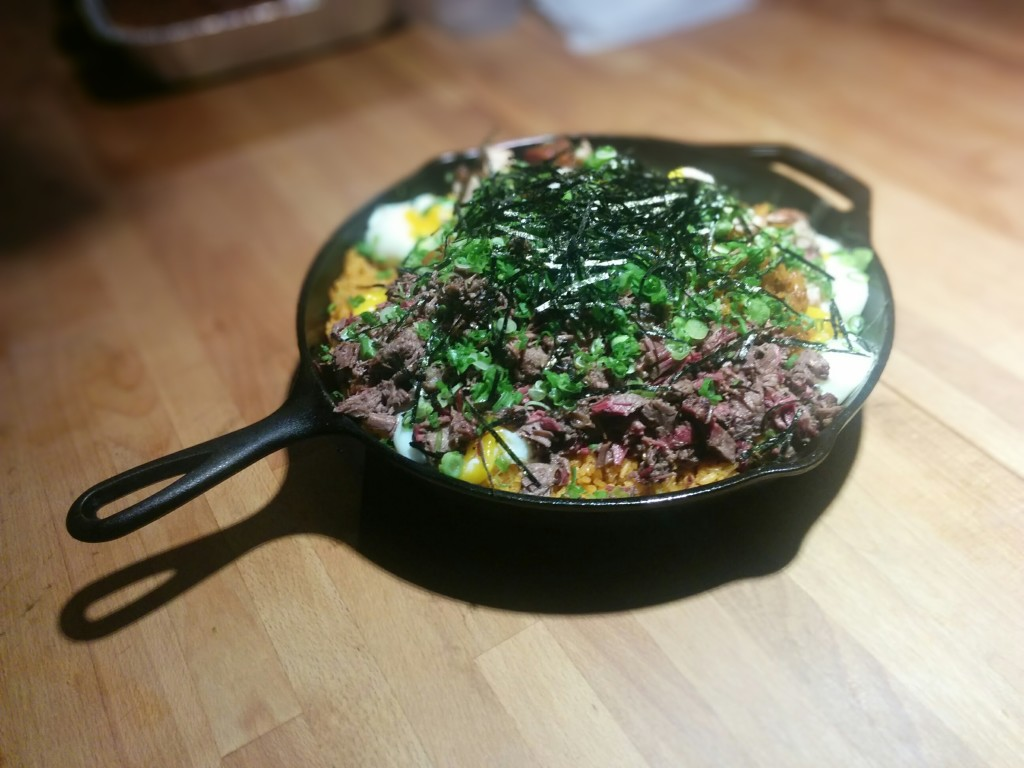 Cast-iron skillet kimchi fried rice with smoked pork belly and 14-hour smoked brisket.